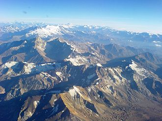 Andes - The Andes mountain range as seen from a plane, between Santiago de Chile and Mendoza, Argentina, in summer. The large icefield corresponds to the southern slope of San José volcano (left) and Marmolejo (right). Tupungato at their right.