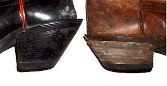 "Cowboy boot - Comparison of the ""cowboy"" heel and the lower ""walking"" heel. Both designs are angled slightly, different from the squared-off ""roper"" heel"