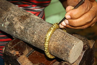 Craftsman Creating Designs on a Brass Bracket, Dhamrai, Savar, Bangladesh NK.JPG
