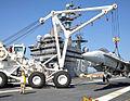 Crane lifts training plane on USS Ronald Reagan (CVN-76) in April 2015.JPG