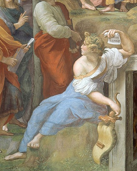 Detail of Sappho from Raphael's Parnassus (1510-11), shown alongside other poets. In her left hand, she holds a scroll with her name written on it. Cropped image of Sappho from Raphael's Parnassus.jpg