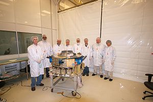 Small Satellite Program (United States Naval Academy) - DRAGONSat integrated into flight payload. USNA Midshipmen  who built the satellite are behind the payload.