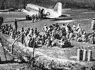 Indian Air Force - Refugees awaiting evacuation by IAF Dakota on Poonch airstrip, December 1947.