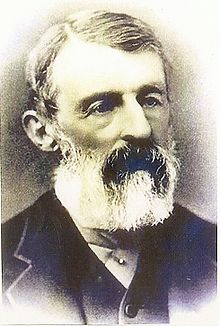 A black and white photograph of Daniel Lucius Adams with white beard and moustache, showing his head and part of the shoulders.