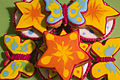 Decorated butterfly and star-shaped cookies.jpg