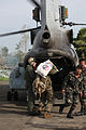 Defense.gov News Photo 101021-M-9842K-178 - U.S. Marines left and Philippine service members load humanitarian aid supplies onto a U.S. Marine Corps CH-46 Sea Knight helicopter in the.jpg