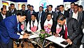 Dharmendra Pradhan and the Chief Minister of Assam, Shri Sarbananda Sonowal witnessing the signing of an MoU on skill development, at the Advantage Assam- Global Investors Summit 2018, in Guwahati, Assam.jpg