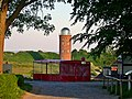 Distant bearing tower through trees while standing in front of new lighthouse - panoramio.jpg
