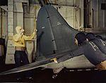 Douglas SBD-5 is pushed in hangar of escort carrier c1944.jpg