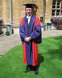 A doctor of philosophy of the University of Oxford, in full academic dress. The typical dress for graduation are gowns and hoods or hats adapted from the daily dress of university staff in the Middle Ages, which was in turn based on the attire worn by medieval clergy. Dphil gown.jpg