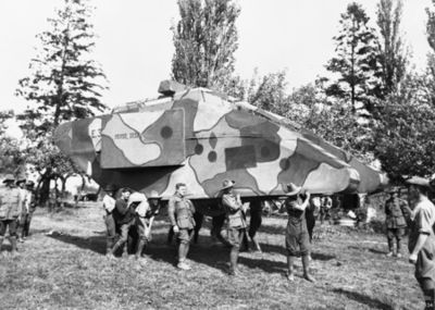 "Troops carry a lightweight wood-framed ""dummy"" tank into position. E04934.jpg"