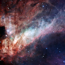 Three-colour composite image of the Omega Nebula (Messier 17, or NGC 6618). Credit w:ESO
