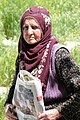 Elderly Woman with Newspaper - Cavusin - Cappadocia - Turkey (5764778649).jpg