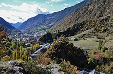 A photograph of Encamp, a small town among high mountains