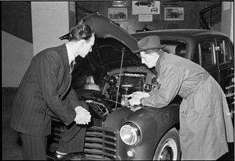 Vauxhall Motors - A buyer and seller looking under the bonnet of a Vauxhall at a dealership in Denmark in the 1950s