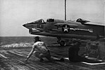 F-8A Crusader of VF-211 is launched from USS Hancock (CVA-19), in 1963.jpg