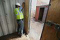 FEMA - 31184 - FEMA contractor works on a tornado shelter in Greensburg, KS.jpg