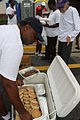 FEMA - 38114 - Food being passed out to evacuees returning to Louisiana.jpg