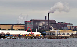 Environmental chemistry - White bags filled with contaminated stones line the shore near an industrial oil spill in Raahe, Finland
