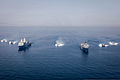 Five U.S. Navy landing craft, air cushion sail in formation with the amphibious transport dock ship USS Green Bay (LPD 20), left, and the amphibious dock landing ship USS Rushmore (LSD 47) during an amphibious 130329-M-HW830-594.jpg