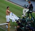Flickr - Carine06 - Rafael Nadal shirt change.jpg