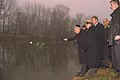 Flickr - Government Press Office (GPO) - PRES. EZER WEIZMAN TOSSING A ROSE INTO THE RIVER IN MEMORY OF TEREZIENSTADT CONCENTRATION CAMP VICTIMS.jpg