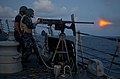 Flickr - Official U.S. Navy Imagery - A Sailor fires a .50-caliber machine gun..jpg