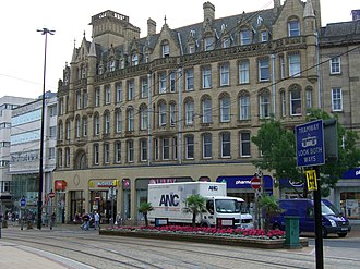 High Street (Sheffield) - The Foster's Buildings, constructed in Huddersfield Stone has impressive pinnacles and parapets .