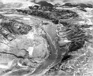 Grand Coulee Dam - The dam site before construction, looking south