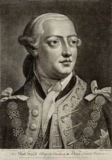 Head-and-shoulders monochrome portrait of a young clean-shaven man wearing a richly-patterned jacket, plain neckcloth, powdered wig, and the chain of office or livery collar of the Order of the Garter.