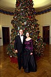 George W. Bush and Laura Bush stand before the Blue Room Christmas Tree.jpg