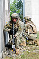 Georgian soldiers with the 32nd Infantry Battalion take cover during a mission rehearsal exercise at the Joint Multinational Readiness Center in Hohenfels, Germany, Aug. 5, 2012 120805-A-GG082-005.jpg