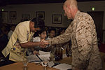 Ginowan, Futenma officials sign agreement specifying disaster preparedness procedures 130626-M-CU214-012.jpg