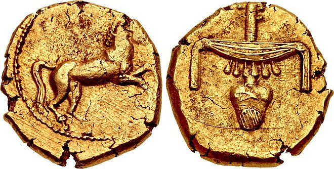 "Egyptian gold stater of Nectanebo II. The design on the reverse consists of Egyptian hieroglyphs meaning ""good gold"": pectoral necklace (nub = ""gold"") crossing horizontally over a windpipe and heart (nefer = ""good""). Gold Stater of Pharaoh Nektanebo II.jpg"