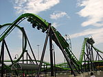 Green roller coaster preparing to go upside-down
