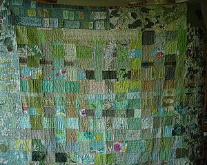 completed quilt top constructed by weaving str...