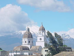 Guaytacama with Cotopaxi volcano in the background