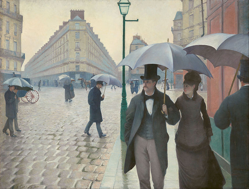A man and woman walking under an umbrella in a Paris road, other walkers-by; costumes of ca. 1877.