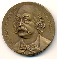 Medaglia con l'effigie di Flaubert, opera di Gaston Bigard. Bronzo, 50mm (1921)
