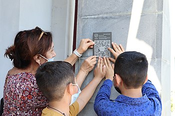 Hanging QR codes on school building in Lernapat (Armenia), Talking Wikipedia, 2020.jpg