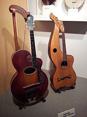 Early 20th. Century harp guitars with a Gibson at left.