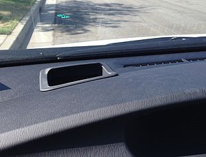 Automotive head-up display - The green arrow on the windshield near the top of this picture is a Head Up Display on a 2013 Toyota Prius. It toggles between the GPS navigation instruction arrow and the speedometer. The arrow is animated to appear scrolling forward as the car approaches the turn. The image is projected without any kind of glass combiner.