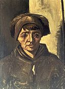 Head of a Peasant Woman with a Dark Cap by Vincent van Gogh.jpg
