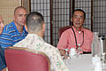 Hironobu Sugawara, an advisor to the Oshima District Disaster Response Center, speaks with U.S. Marine Maj. Gen. Peter J. Talleri, Command Genral, Marine Corps Base Camp Smedley D. Butler, about the events 110807-M-NR225-011.jpg