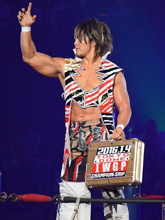 Wrestle Kingdom 10 - Hiroshi Tanahashi holding a briefcase containing the contract for an IWGP Heavyweight Championship match at Wrestle Kingdom 10