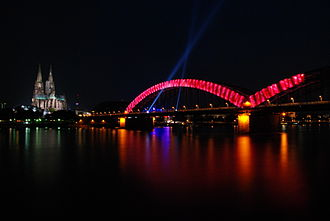 German Evangelical Church Assembly - Illumination on the Hohenzollern Bridge for Deutscher Evangelischer Kirchentag 2007. Cologne Cathedral is in the background.