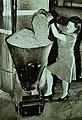 House wife is filling the hopper of the household sawdust burner, 1942 (23681690775).jpg