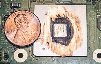 Gekko (microprocessor) - 180nm IBM Gekko CPU in the Nintendo Gamecube shaven down to expose the silicon die.