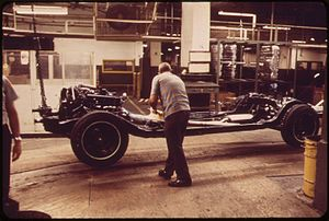 Cadillac - Installing a transmission on a Cadillac in Wayne, Michigan, 1973