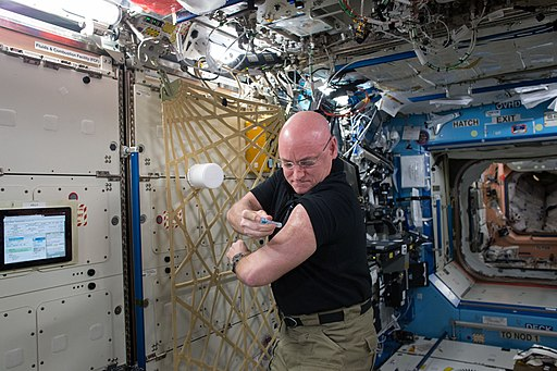 ISS-45 Scott Kelly flu shot in the Destiny lab